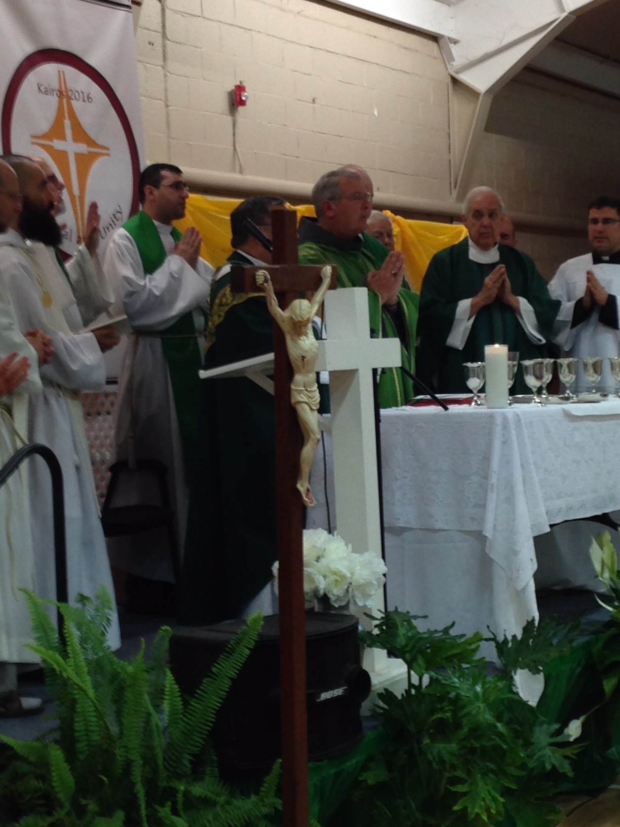 Priests praying during Mass