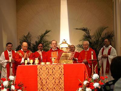 Priests praying during Mass